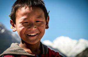 A Tibetan boy, son of the Plantation Caretaker, at the apple tre